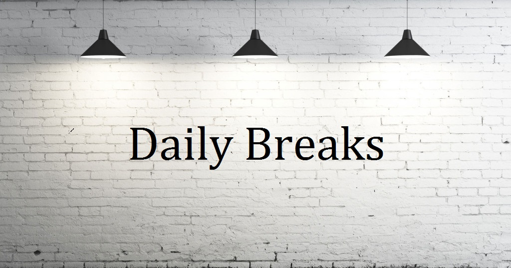 picture of a white wall with 3 lights and the word Daily break written on the wall