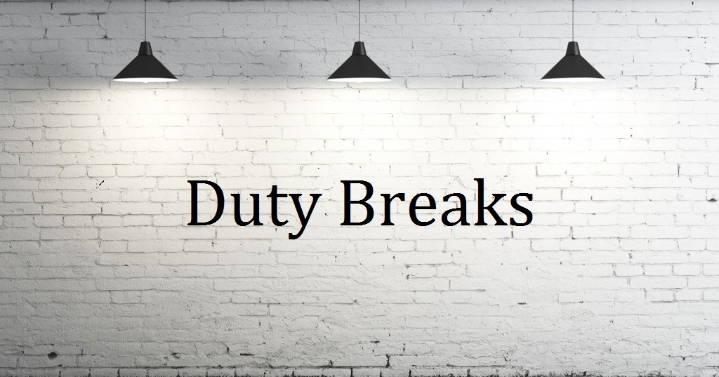 picture of a white wall with 3 lights and the word duty break written on the wall