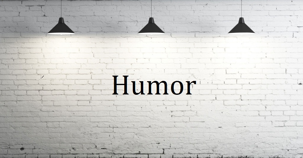picture of a white wall with 3 lights and the word humor written on the wall